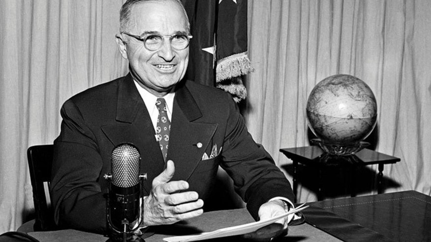 FILE Sept. 1, 1945: President Harry Truman sits before a microphone at the White House in Washington, where he broadcast a message on the formal surrender of Japan.
