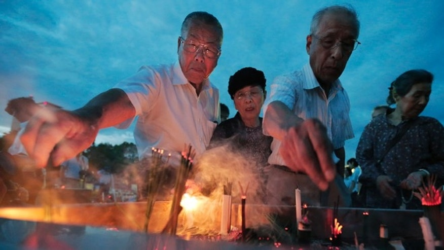 Aug. 6, 2012: People burn incenses and pray in front of the cenotaph dedicated to the victims of the atomic bombing at the Peace Memorial Park as they mark the 67th anniversary of the world&#39&#x3b;s first atomic bombing, in Hiroshima, western Japan.
