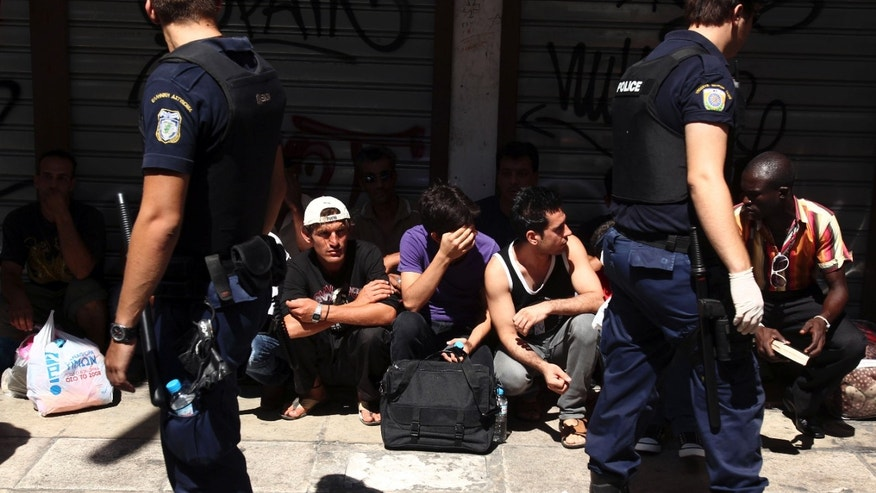 Aug. 5, 2012: Police detain a group of migrants in central Athens. Greek police say officers have begun an operation to arrest and deport illegal migrants from the center of the capital and along the countrys northeastern border.