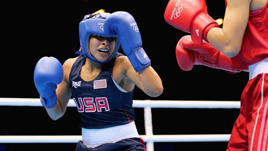 Marlen Esparza of the United States in action against Cancan Ren of China during the Women's Fly (51kg) Boxing.