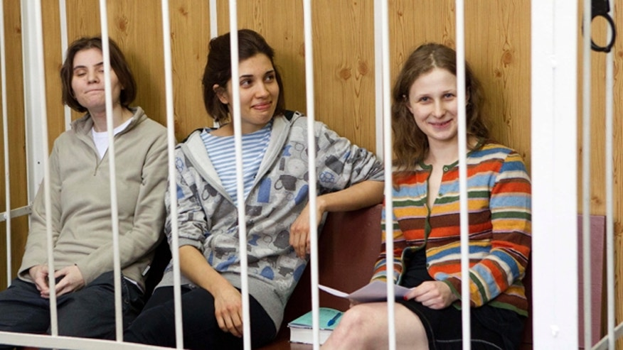 July 20, 2012: From left, Yekaterina Samutsevich, Nadezhda Tolokonnikova, Maria Alekhina, members of feminist punk group Pussy Riot sit behind bars at a court room in Moscow, Russia.