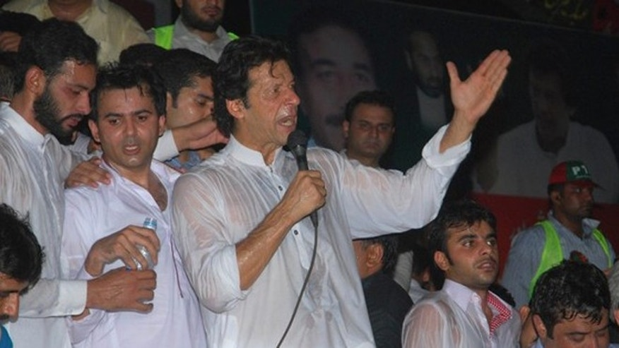 July 5, 2012: Pakistani former cricket star-turn-politician Imran Khan condemns the movement of NATO supplies to Afghanistan through Pakistan at a rally in Gujranwala near  Lahore, Pakistan.
