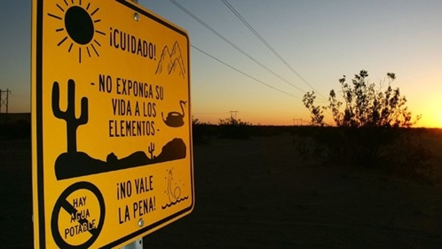 WINTERHAVEN, CA - OCTOBER 08:  An official south-facing sign cautions north-bound illegal immigrants of dangers in the desert trek adding that it is not worth the risk, along the US-Mexico border where no fence divides the two nations near the Imperial Dunes on October 8, 2006 west of Winterhaven, California. The warning includes heat, rugged terrain, rattlesnakes, lack of drinking water, and the risk of drowning in the All American Canal which parallels the border a short distance to the north.. US Fish and Wildlife Service wardens and environmentalists warn that a proposed plan by US lawmakers to construct 700 miles of double fencing along the 2,000-mile US-Mexico border, in an attempt to wall-out illegal immigrants, would also harm rare wildlife.  Wildlife experts say cactus-pollinating insects would fly around fence lights, birds that migrate by starlight in the desert wilderness would be confused; and large mammals such as jaguars, Mexican wolves, Sonoran pronghorn antelope, and desert bighorn sheep would be blocked from migrating across the international border, from California to Texas.  (Photo by David McNew/Getty Images)