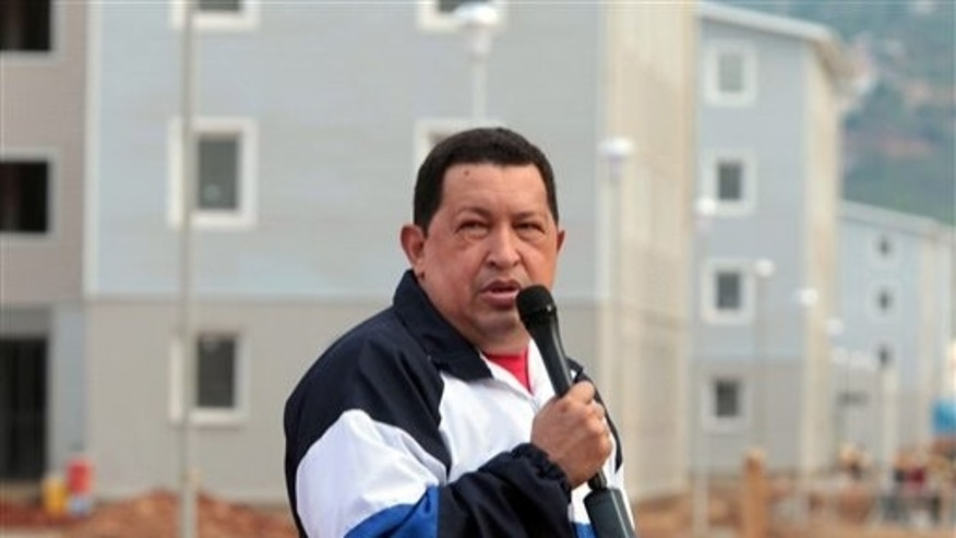Aug. 9, 2012 - In this photo released by Miraflores Press Office, Venezuela's President Hugo Chavez speaks during a visit to a housing complex at Catia la Mar, Venezuela.