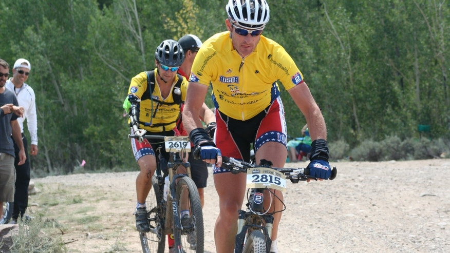 Ken Butler of the 82nd Airborne, shown left, participates in the Leadville 100.