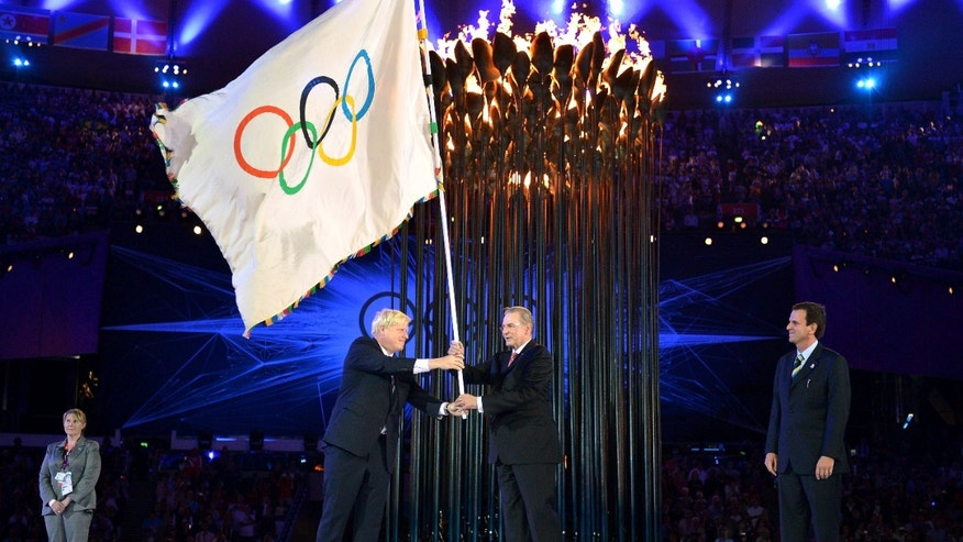 Aug. 12, 2012: The Olympics flag is handed from London Mayor, Boris Johnson, second from left, to the International Olympic Committee President Jacques Rogge, as the Mayor of Rio de Janeiro, Eduardo Paes, right, watches during the Closing Ceremony of the 2012 Summer Olympic in London.