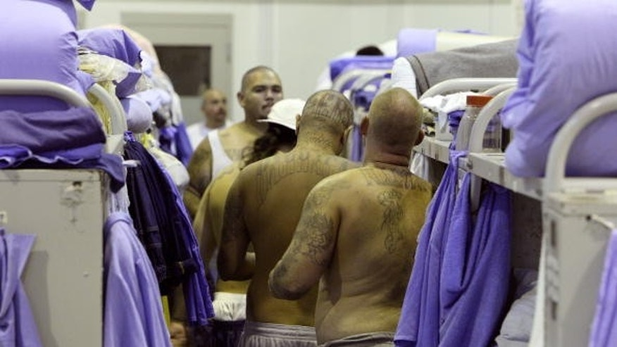 IONE, CA - AUGUST 28:  Inmates at the Mule Creek State Prison crowd between bunk beds in a gymnasium that was modified to house prisoners August 28, 2007 in Ione, California. A panel of three federal judges is looking to put a cap on the California State Prison population after class action lawsuits were filed on behalf of inmates who complained of being forced to live in classrooms, gymnasiums and other non-traditional prison housing. California prisons house nearly 173,000 inmates with over 17,000 of them in non-traditional housing. The Mule Creek State Prison has had to modify several facilities to make room for an increasing number of inmates. (Photo by Justin Sullivan/Getty Images)
