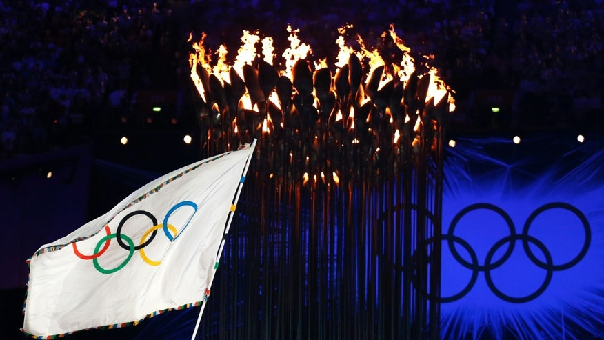 President of the International Olympic Committee Jacques Rogge, left, hands the Olympic flag to Rio de Janeiro's mayor Eduardo Paes during the Closing Ceremony at the 2012 Summer Olympics, Sunday, Aug. 12, 2012, in London. (AP Photo/Matt Dunham)