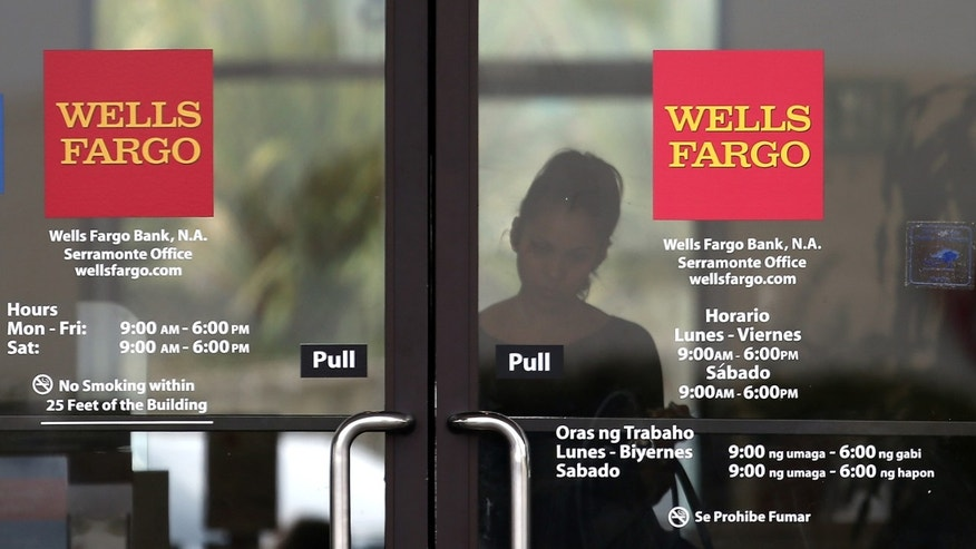 DALY CITY, CA - JULY 12: A customer prepares to leave a Wells Fargo Bank branch office on July 12, 2012 in Daly City, California. The Justice Department announced Thursday that Wells Fargo Bank, the largest residential home mortgage originator in the United States, will pay nearly $175 million to settle accusations of discrimination against qualified African-American and Hispanic borrowers between 2004 and 2009. The alleged discrimination is in violation of fair-lending laws. (Photo by Justin Sullivan/Getty Images)