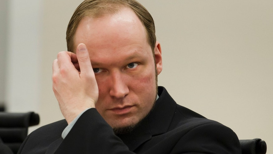 Confessed mass killer Anders Behring Breivik sits in the courtroom in Oslo, Norway Friday 1 June, 2012. Norwegian police said they are confident that confessed mass killer Anders Behring Breivik acted on his own in terror attacks last year that killed 77 people and that they found no evidence he belonged to a Europe-wide anti-Muslim network. (AP Photo/Heiko Junge,Pool)