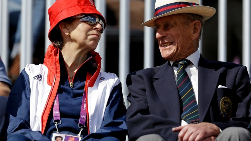 Princess Anne, left, mother of Great Britain equestrian rider Zara Phillips, attends the equestrian eventing dressage phase with Prince Phillip the Duke of Edinburgh, husband of Britain's Queen Elizabeth II, at the 2012 Summer Olympics, Sunday, July 29, 2012, in London. (AP Photo/David Goldman)