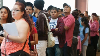 Young immigrants stand in a long line at Chicago's Navy Pier on Wednesday, Aug. 15, 2012, for guidance with a new federal program that would help them work legally in the United States and avoid deportation. At least 11,000 people showed up for the workshop led by immigrant rights advocates for help in putting together identity documents and filling out the detailed forms on the first day that the federal government began accepting applications. (AP Photo/Sitthixay Ditthavong)