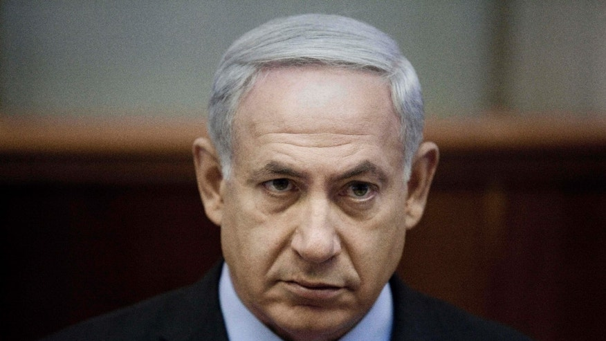Israeli Prime Minister Benjamin Netanyahu chairs the weekly cabinet meeting at the Prime Minister's Office in Jerusalem, Sunday, Aug. 12, 2012. With attack rhetoric heating up, Israels prime minister says the threat from Iran dwarfs all others. Netanyahu told his Cabinet on Sunday, Iran must not be allowed to obtain nuclear weapons. (AP Photo/Abir Sultan, Pool)