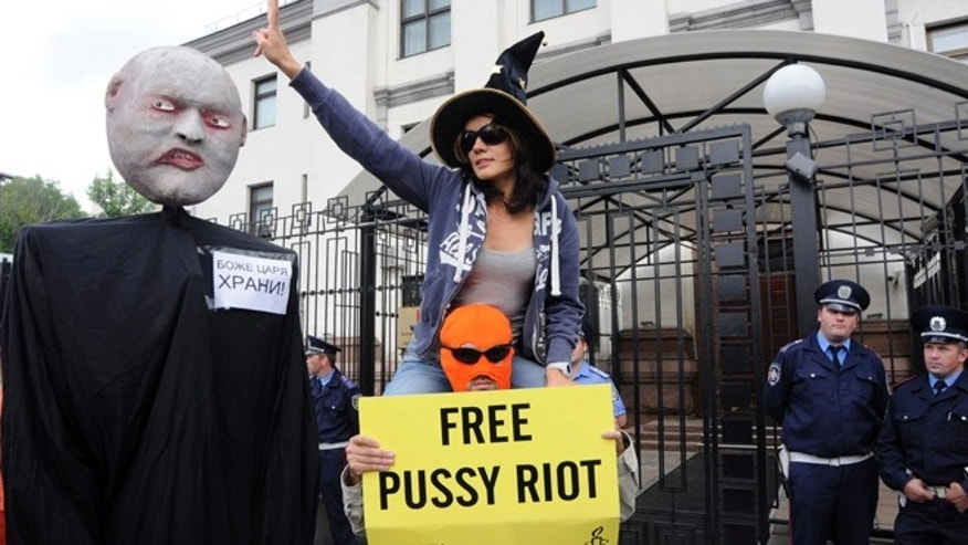 Aug. 17, 2012: Demonstrators attend a demonstration in support of the Russian punk group Pussy Riot, whose members face prison for a stunt against President Vladimir Putin, outside the Russian Embassy in Kiev, Ukraine.