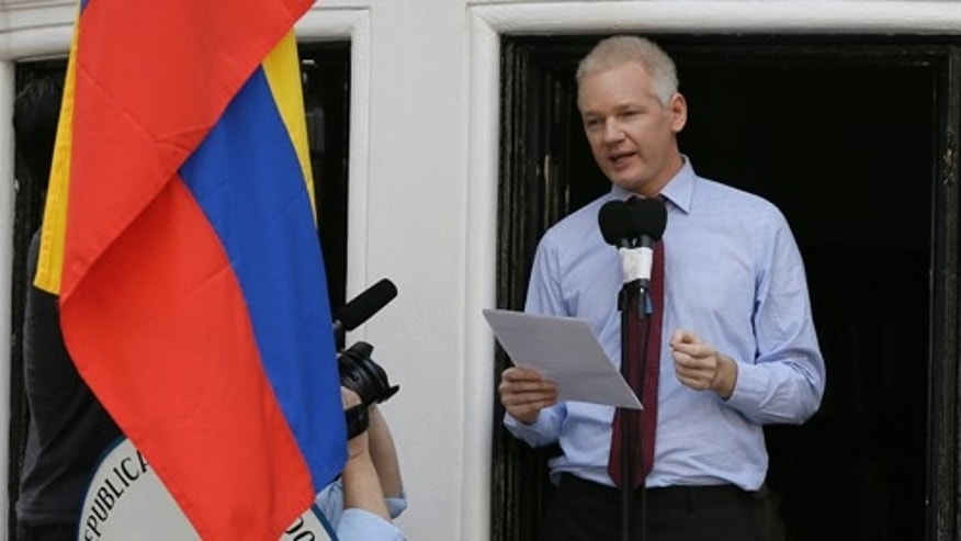 "Julian Assange, founder of WikiLeaks makes a statement from a balcony of the Equador Embassy in London, Sunday, Aug. 19, 2012. Assange called on United States President Barack Obama to end a ""witch hunt"" against the secret-spilling WikiLeaks organization.(AP Photo/Kirsty Wigglesworth)"