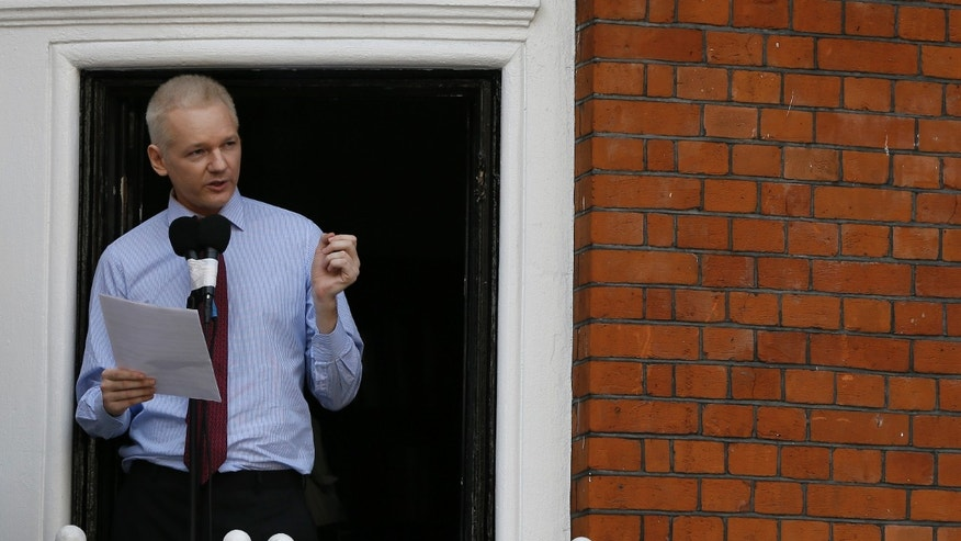 "Aug. 19, 2012: Julian Assange, founder of WikiLeaks makes a statement from a balcony of the Equador Embassy in London.  Assange called on United States President Barack Obama to end a ""witch hunt"" against the secret-spilling WikiLeaks organization."