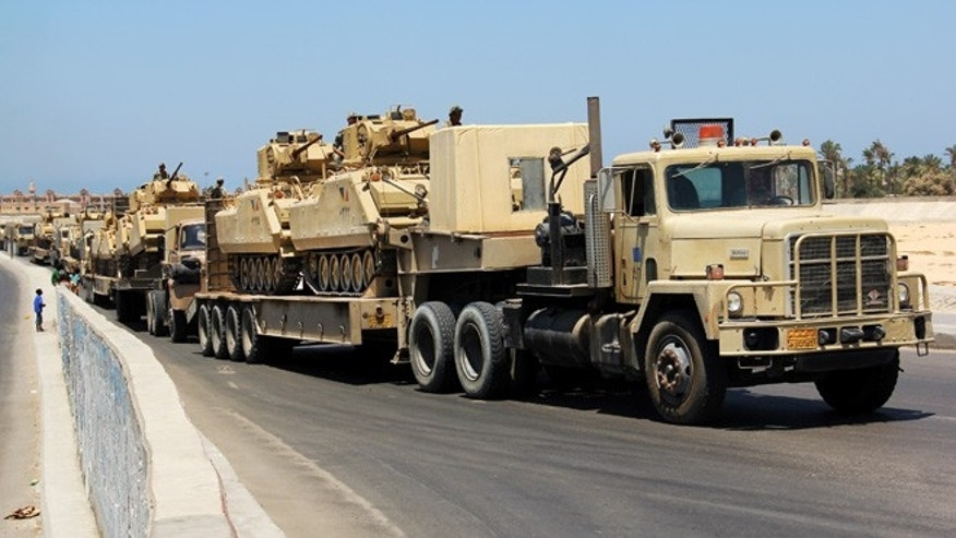 Aug. 9. 2012: In this file photo,  army trucks carry Egyptian military tanks in El Arish, Egypt's northern Sinai Peninsula.