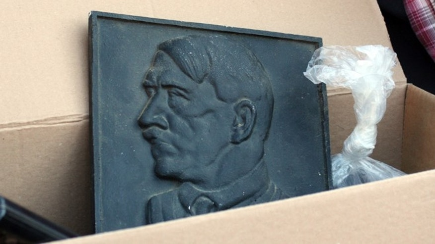 August 23, 2012: A representation of Adolf Hitler lies in a box after police searched the house of an alleged neo-Nazi in Juelich, western Germany.