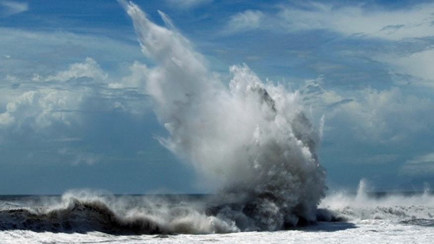 Aug. 23, 2012: Strong waves batter breakwaters from approaching Typhoon Tembin in the coastal village of Ilan, Taiwan.