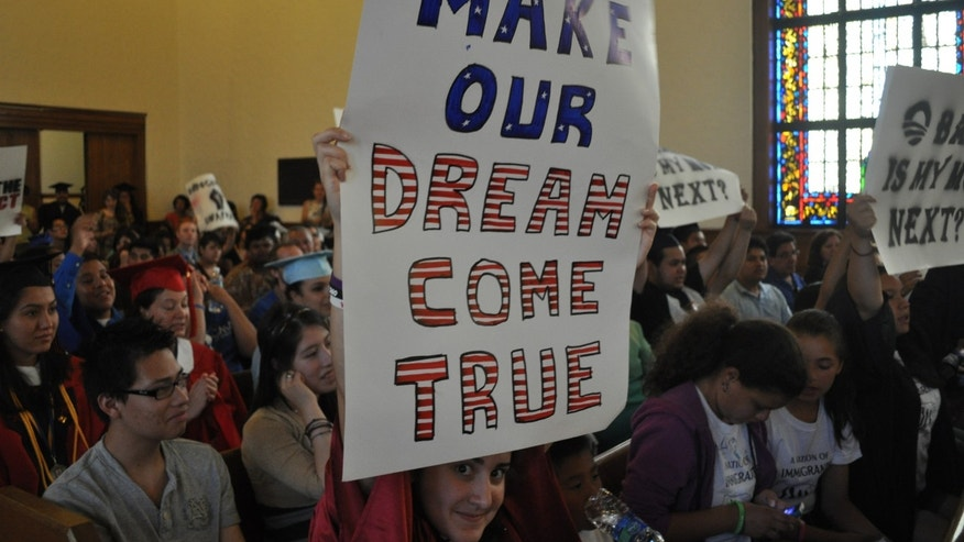 File: Over 250 so-called DREAMers, or undocumented youth who have been brought into the United States illegally by their parents, hold their annual DREAM Act Graduation, then march and protest outside of the Supreme Court of the United States.