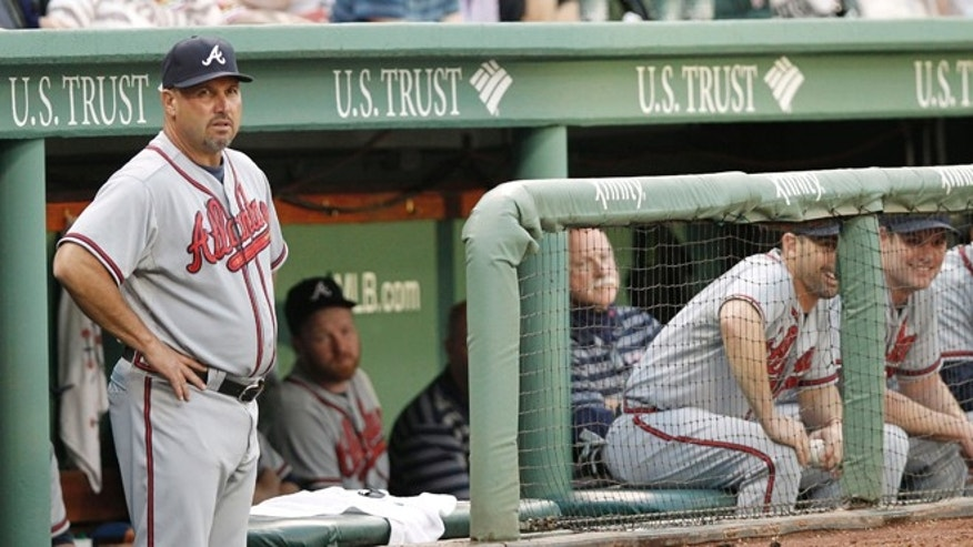 BOSTON, MA - JUNE 23:  Manager Fredi Gonzalez #33 of the Atlanta Braves looks on from the dugout during the second inning of the interleague game against the Boston Red Sox at Fenway Park on June 23, 2012 in Boston, Massachusetts.  (Photo by Winslow Townson/Getty Images)