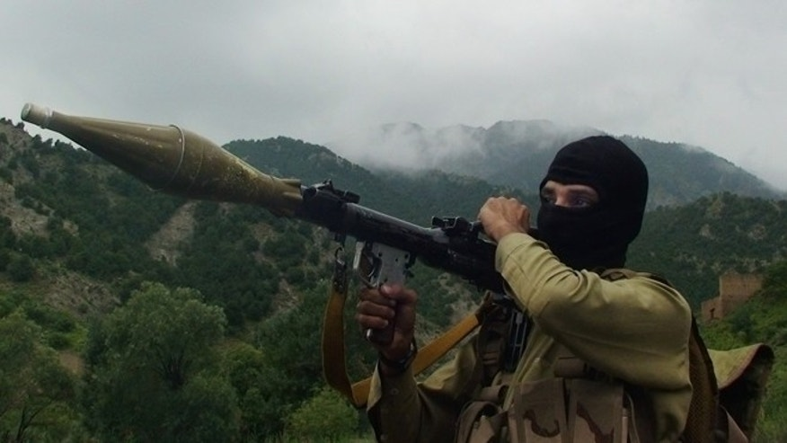 In this photo taken on Aug. 5, 2012, a Pakistani Taliban militant holds a rocket-propelled grenade at the Taliban stronghold of Shawal, South Waziristan, Pakistan. Taliban leaders will hold a meeting to decide whether a Pakistani cricket star-turned-politician Imran Khan will be allowed to hold a planned march to their tribal stronghold to protest U.S. drone strikes, the militant group's spokesman said Thursday. (AP Photo/ Ishtiaq Mahsud)