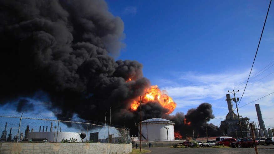 Aug. 27, 2012: Plumes of black smoke and flames continue to rise over the Amuay refinery near Punto Fijo, Venezuela.