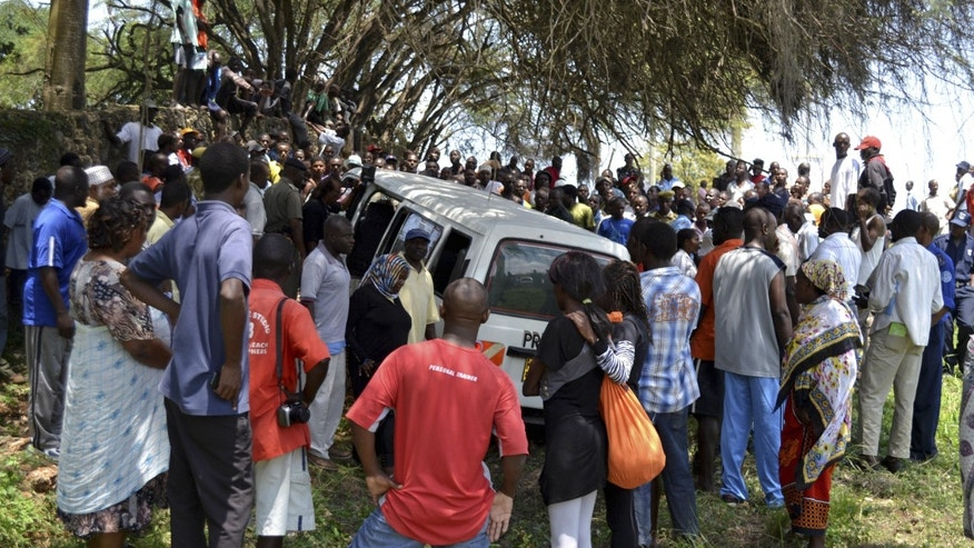 Aug. 27, 2012: Members of the public gather at the scene where Aboud Rogo was shot and killed in a beach area of Mombasa, Kenya, according to local sources.