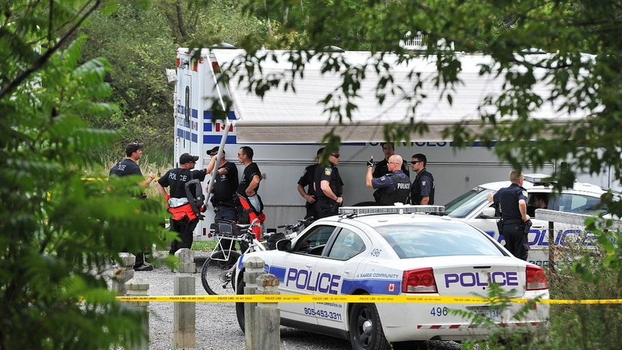 Aug. 16, 2012 - FILE photo of police team in Hewick Meadows Park in Mississauga, Ont., after discovering a female severed head in the Credit River.