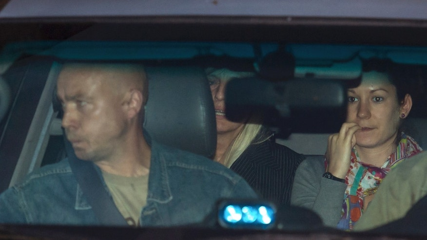 Aug. 28, 2012: Michelle Martin, partially obscured at center, ex-wife of Belgium's child killer Marc Dutroux leaves prison in Brussels.