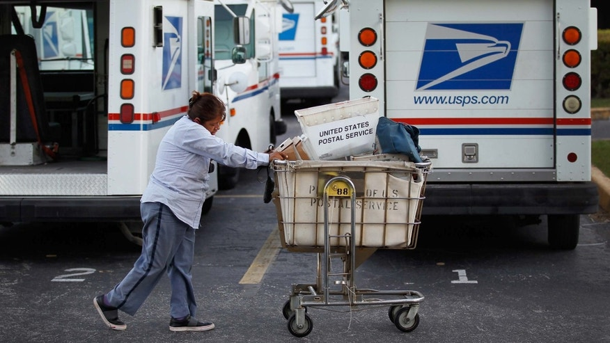 FORT LAUDERDALE, FL - SEPTEMBER 16:  A United States Postal Service employee pushes a cart at the mail processing center on September 16, 2011 in Fort Lauderdale, Florida. The U.S. Postal Service announced Thursday what they consider major cost-saving changes that include studying whether to close mail processing centers in Pembroke Pines and the one in Fort Lauderdale. The potential closings of 250 facilities nationwide are part of an effort to save up to $3 billion a year. (Photo by Joe Raedle/Getty Images)