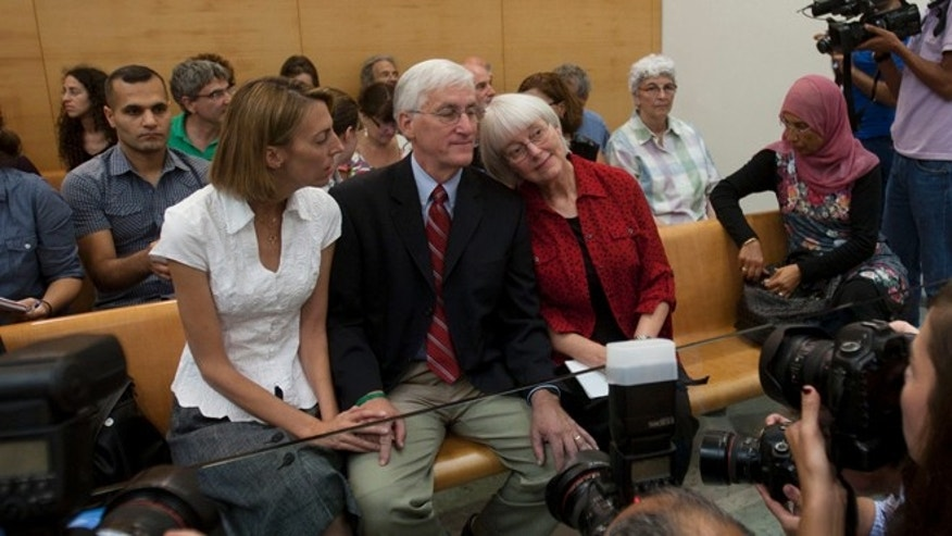 Aug. 28, 2012: Cindy, center right, and Craig Corrie, center, the parents of Rachel Corrie, a pro-Palestinian activist who was killed by an Israeli bulldozer in Gaza in 2003, sit together with their daughter Sarah, center left,  in the court room just before the district court's ruling in Haifa, Israel.