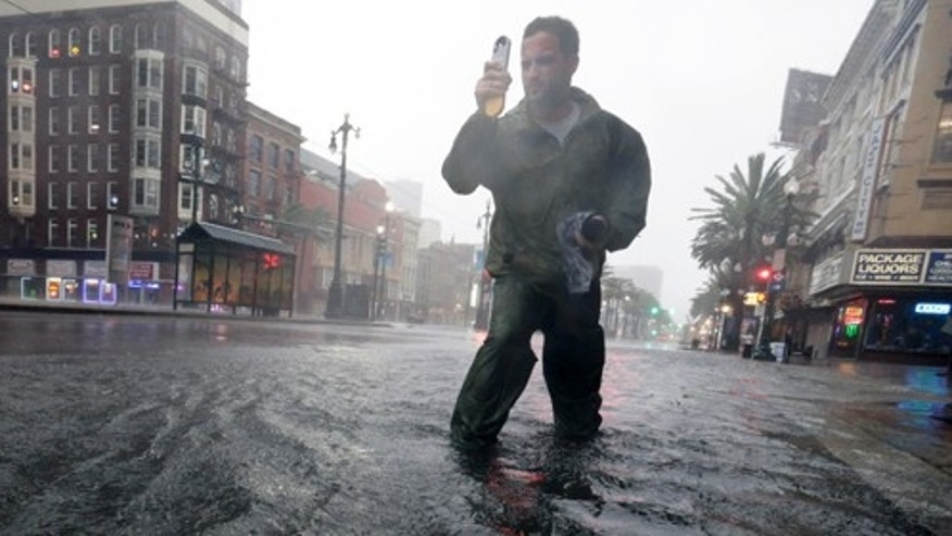 A research student from the the University of Alabama measures wind speeds as Hurricane Isaac makes landfall, Wednesday, Aug. 29, 2012, in New Orleans, La.  (AP Photo/Eric Gay)