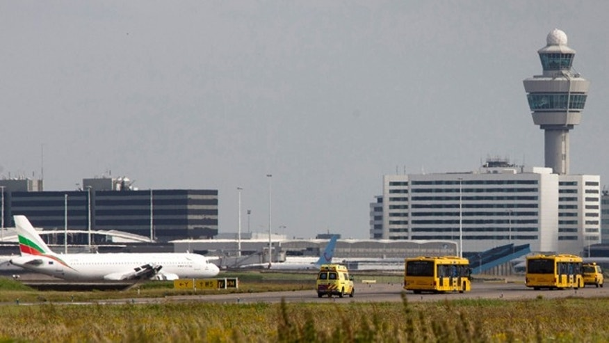August 29, 2012: Passengers from a Vueling plane leave in a bus at Amsterdam's Schiphol Airport, Netherlands.
