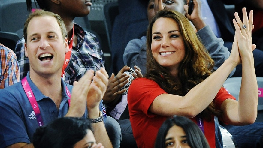 Britain's Prince William and his wife Kate Duchess of Cambridge  watch British cyclist Sarah Storey break a world record in her C5 Individual Pursuit heat at the Paralympic Games in  London.  (AP Photo/Stefan Rousseau/Pool)