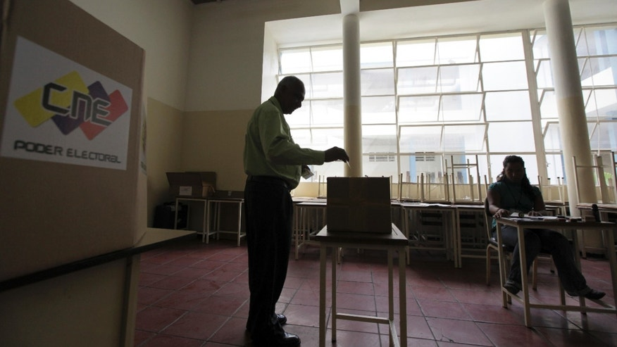 Sept. 2, 2012: A man casts his ballot during a voting drill in Caracas, Venezuela.