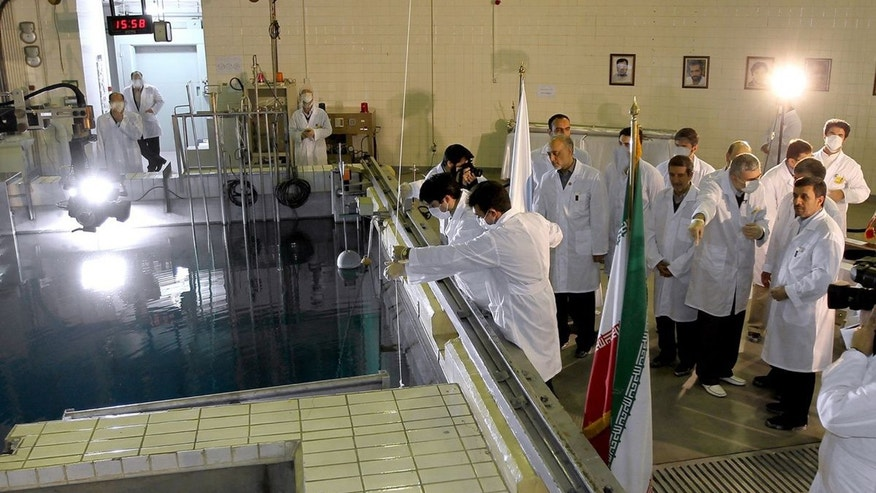 FILE- In this Feb. 15, 2012, file photo, provided by the Iranian President&#39&#x3b;s Office, Iranian President Mahmoud Ahmadinejad, right, is escorted by technicians during a tour of Tehran&#39&#x3b;s research reactor center in northern Tehran, Iran. Iran&#39&#x3b;s envoys are heading for nuclear talks with confidence that the chips are falling their way. Iran&#39&#x3b;s denials that it is trying to develop nuclear weapons carry a distinctly hollow ring among its  foes as the U.N. nuclear watchdog piles on worries: Complaining about limits on inspection access and reporting that Tehran is expanding its nuclear fuel labs. But, as Israel increasingly weighs the option of a military strike, Western leaders wary of another Middle East conflict may have to pay closer attention to the claims.  (AP Photo/Iranian President&#39&#x3b;s Office, File)