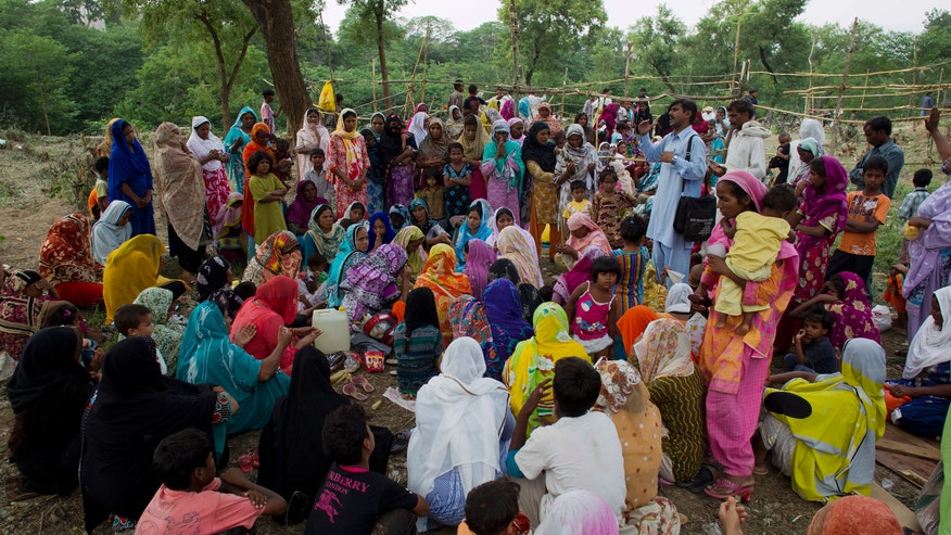 Aug. 27, 2012 - Pakistani Christians from a neighborhood where a girl was arrested on alleged blasphemy charges pray in a clearing of an urban forest in Islamabad, Pakistan.