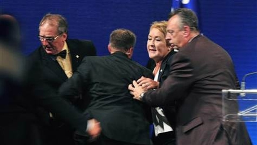 Sept. 4, 2012: Parti Quebecois Leader Pauline Marois is whisked off stage as she delivered her victory speech in Quebec.