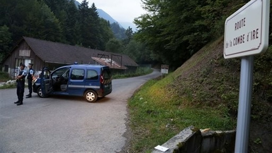 Sept. 5, 2012: Gendarmes block access to a killing site near Chevaline, French Alps.