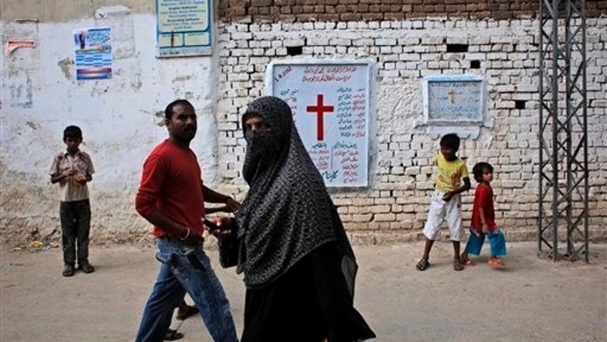 Aug. 30, 2012: Pakistanis walk in a Christian neighborhood in Islamabad, Pakistan.