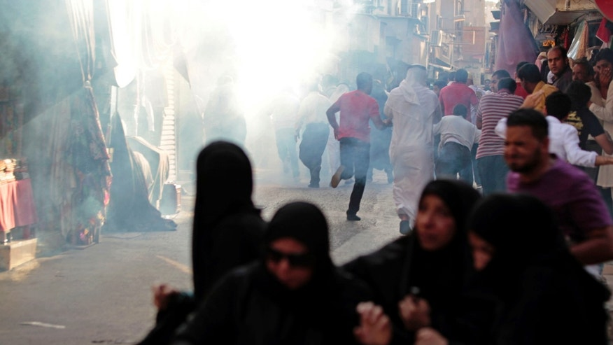 Sept. 7, 2012 - Bahraini anti-government protesters run from tear gas fired by riot police in the heart of the Gulf's kingdom's capital Manama, Bahrain.