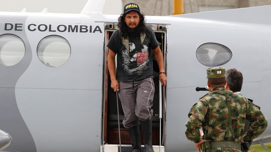 Sept. 10, 2012: Former hostage Orlando Sigifredo Ibarra Sarmiento exits a plane at a military base in Bogota, Colombia.