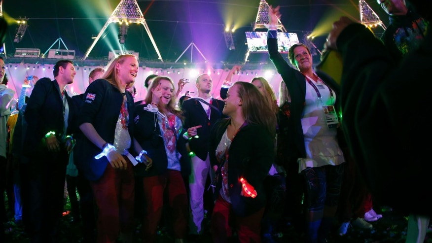Sept. 9, 2012 - British swimmer Ellie Simmonds, third right, dances at the end of the closing ceremony for the 2012 Paralympics games in London.