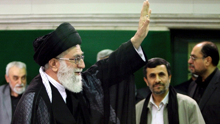 May 7, 2011: FILE- In this file photo released by an official website of the Iranian supreme leader's office, Iranian supreme leader Ayatollah Ali Khamenei, left, waves to his well wishers, unseen, as President Mahmoud Ahmadinejad, second right, looks on, in a religious ceremony, in Tehran, Iran.