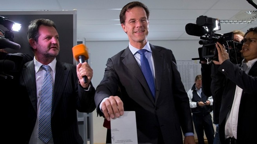 Sept. 12, 2012: Dutch Prime Minister and Liberal Party leader Mark Rutte casts his vote for parliamentary elections in The Hague, Netherlands.