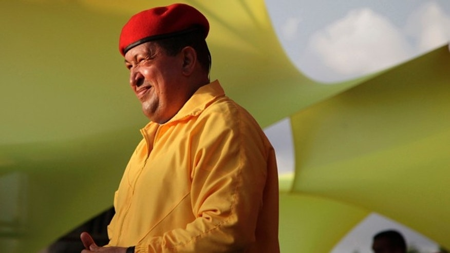 FILE - In this July 14, 2012 file photo, Venezuela's President Hugo Chavez smiles at a campaign rally in Barquisimeto, Venezuela. When he takes the stage at campaign rallies, Chavez stands alone. Under Venezuela's election system, presidential hopefuls dont choose running mates. The lack of a No. 2 leaves voters with a big unknown ahead of next month's presidential election and raises question about who in fact would take over were Chavez to win and leave office prematurely. (AP Photo/Ariana Cubillos,File)