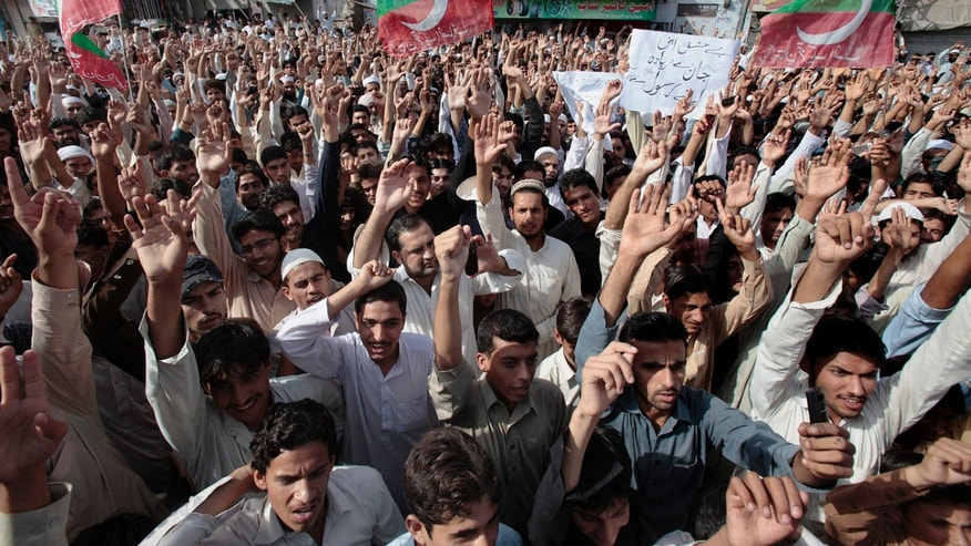 Sept. 16, 2012: Supporters of a Pakistani Tehreek-e-Insaf or Movement for Justice chant slogans during a demonstration in Peshawar, Pakistan, as part of widespread anger across the Muslim world about a film ridiculing Islam's Prophet Muhammad.