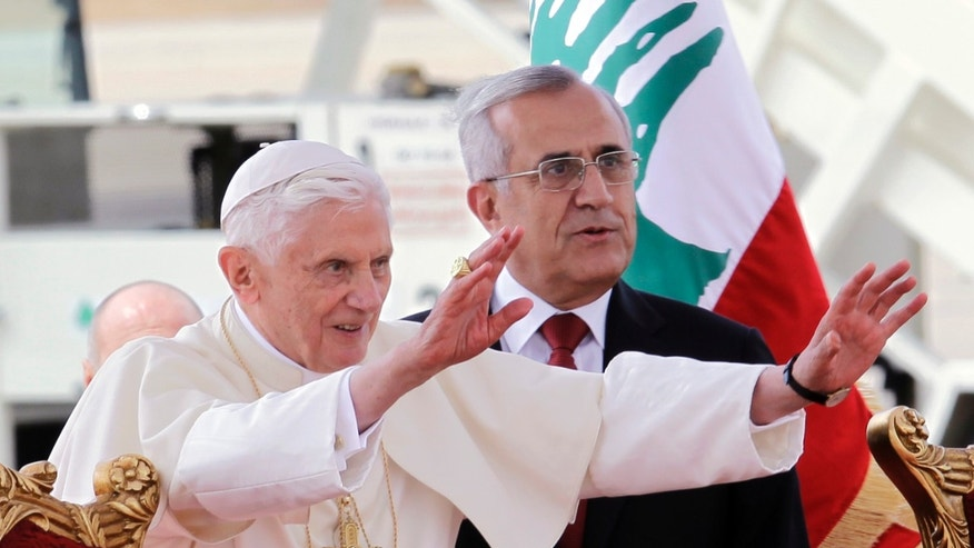 Sept. 14, 2012: Pope Benedict XVI stands next to Lebanese President Michel Suleiman as he waves to the crowd at Rafik Hariri international airport, in Beirut, Lebanon.
