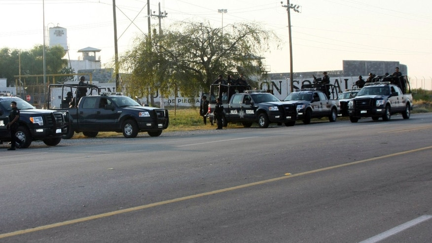 Sept. 17, 2012: A group of Mexican federal police stand in front of the prison in Piedras Negras, Mexico.